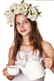 Beautiful girl wearing a wreath of jasmine and a cup of green tea Royalty Free Stock Photography