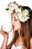 Beautiful girl wearing a wreath of jasmine and a cup of green tea. On an isolated white background Stock Images