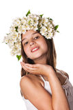 Beautiful girl wearing a wreath of jasmine and a cup of green tea Stock Photography
