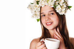 Beautiful girl wearing a wreath of jasmine and a cup of green tea. On an isolated white background Royalty Free Stock Photo