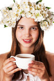 Beautiful girl wearing a wreath of jasmine and a cup of green tea. On an isolated white background Stock Photography