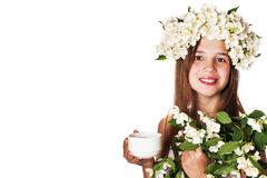 Beautiful girl wearing a wreath of jasmine and a cup of green tea. On an isolated white background Royalty Free Stock Photography