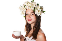 Beautiful girl wearing a wreath of jasmine and a cup of green tea. On an isolated white background Stock Image