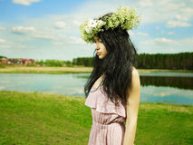 Beautiful girl wearing a wreath of wildflowers Royalty Free Stock Images