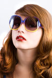 Beautiful girl wears sunglasses Royalty Free Stock Photos