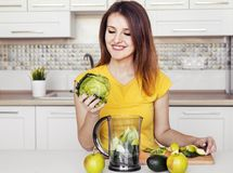 Girl Preparing Glass of Smoozie Royalty Free Stock Images