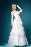 Beautiful girl in wedding dress on blue background Royalty Free Stock Photos