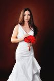 Beautiful girl in a wedding dress with a bouquet Stock Photography