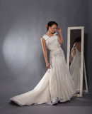 Beautiful girl in a wedding dress Stock Images
