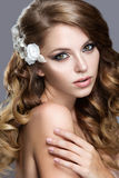 Beautiful girl in wedding image with flowers in her hair Royalty Free Stock Images