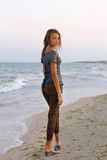 Beautiful girl in a wet dress. At the beach Royalty Free Stock Photo