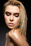 Beautiful girl with a wet hair and creative bright makeup. Beauty face. Photo was made in studio Royalty Free Stock Photo