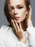Beautiful girl with wet hair and make-up. Fashion woman in white dress with make up Stock Photo