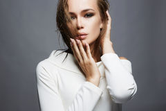 Beautiful girl with wet hair and make-up. Fashion woman in white dress with make up Royalty Free Stock Photo