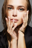Beautiful girl with wet hair and make-up. Woman face.fashion beauty make up Stock Images