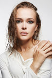 Beautiful girl with wet hair and make-up. Beautiful woman with wet hair and make-up.model girl in white dress.fashion beauty make up Royalty Free Stock Images