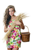 The beautiful girl with wheat ears Stock Photography
