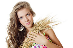 The beautiful girl with wheat ears. Isolated Stock Photos