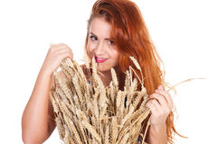 The beautiful girl with wheat ears isolated Royalty Free Stock Photo