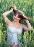Beautiful girl In a wheat field Stock Images