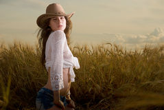 Beautiful girl in wheat field on sunset Royalty Free Stock Images