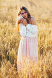 Beautiful girl in wheat field at sunset Royalty Free Stock Photography