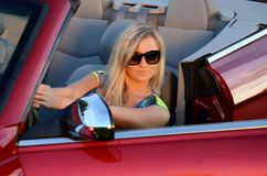 The beautiful girl at the wheel the car Stock Photography
