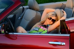 The beautiful girl at the wheel the car Royalty Free Stock Photo