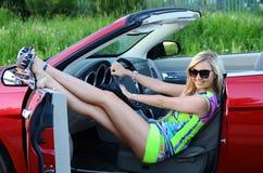 The beautiful girl at the wheel the car stock photos