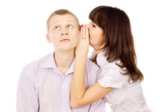 Beautiful the girl whispers to the guy in the ear Stock Photography
