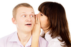 Beautiful the girl whispers to the guy in the ear Stock Image