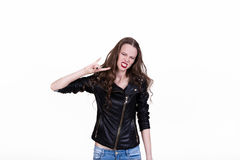 Beautiful girl on a white background. Girl in a black leather jacket loves rock Royalty Free Stock Photos