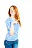 Beautiful girl on a white background  shows Royalty Free Stock Photography