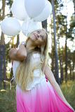 Beautiful girl with white balloons Stock Photos