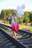 Beautiful girl with white balloons Stock Photo