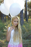 Beautiful girl with white balloons Royalty Free Stock Photo