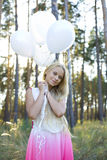Beautiful girl with white balloons Royalty Free Stock Images