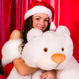 Beautiful girl with white bear Royalty Free Stock Photos