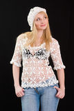 Beautiful girl in white beret and knitted jacket. Royalty Free Stock Photos