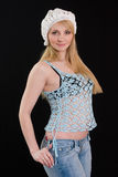 Beautiful girl in white beret and knitted jacket. Royalty Free Stock Photography
