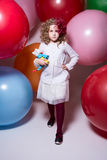 Beautiful girl in a white blouse with a soft toy comes at camera Royalty Free Stock Photography