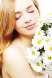 Beautiful girl with white chrysanthemum Stock Images