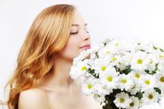 Beautiful girl with white chrysanthemum Royalty Free Stock Photos