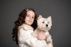 Beautiful girl with a white dog. Beautiful girl with a white fluffy dog Royalty Free Stock Photo
