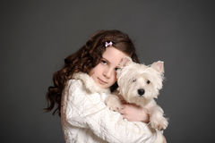 Beautiful girl with a white dog. Beautiful girl with a white fluffy dog Royalty Free Stock Image