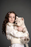 Beautiful girl with a white dog. Beautiful girl with a white fluffy dog Stock Photo