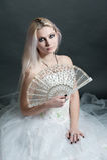 Beautiful girl in white dress on black Stock Image