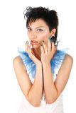 Beautiful girl in a white dress with blue nails Royalty Free Stock Images