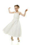 Beautiful girl in white dress dancing Stock Images