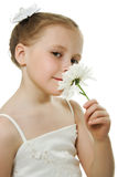 Beautiful girl in white dress with a flower Stock Images